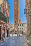 Old medieval tower in a square in Noli, Italy royalty free stock photography