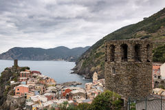 Old medieval watchtower and old houses on cliffs of  Vernazza town at Cinque Terre national park, Italy Stock Photo
