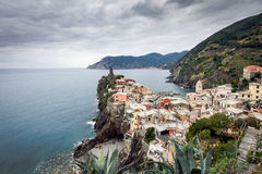 Old medieval watchtower and old houses on cliffs of  Vernazza town at Cinque Terre national park, Italy Stock Photos