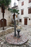 Old medieval water pump in old town of Kotor Stock Photo