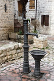Old medieval water pump in old town of Kotor Stock Images