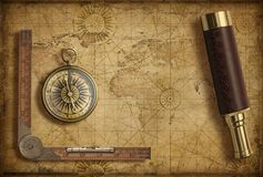 Old medieval world map with compass and spyglass. Adventure and travel concept. 3d illustration. stock photos