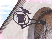 Old medieval wrought iron sign on the door Stock Images