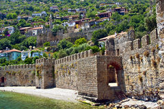 Old Mediterranean Town Behind Fortress Wall Near t. Old Mediterranean Town of Alanya Behind Fortress Wall Near the Sea, Turkey Stock Image