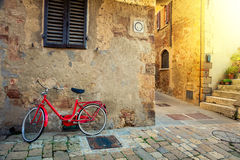 Old Mediterranean town street with red retro bike Stock Photo