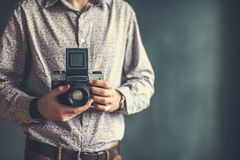 Old medium format camera in photographer hands Royalty Free Stock Photos