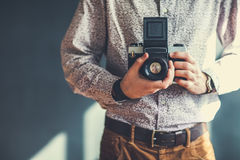 Old medium format camera in photographer hands Royalty Free Stock Photo