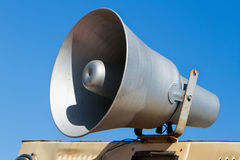 Old megaphone on background of sky, speaker loudspeaker Royalty Free Stock Images