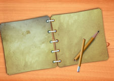 Old memo pad and a broken pencil Stock Images