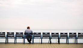 Old men on the bench. Old men relax on the bench on the sea coast Royalty Free Stock Image