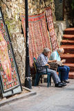 Old men checking their cellphones Stock Images