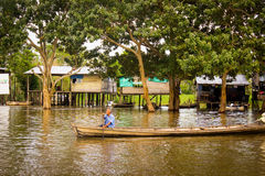 Old men doing canoeing at amazon river Stock Image