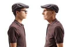 Old man looking at his younger self. Old men looking at his younger self isolated on white background royalty free stock image