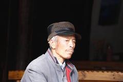 An old men at the market in Yunnan, China royalty free stock photos