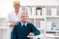 Old men with nurse Royalty Free Stock Images