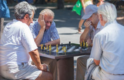 Old men playing chess Royalty Free Stock Images