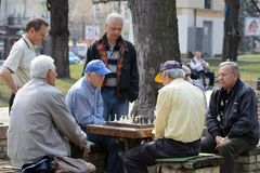 Old men playing chess Stock Photo