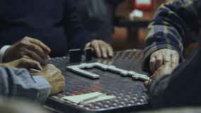 Old men playing dominoes stock video footage