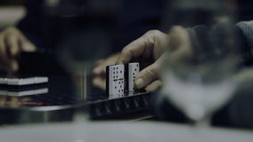 Old men playing dominoes stock video