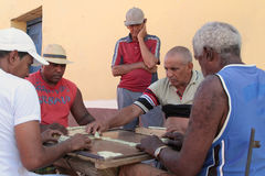 Old men playing dominoes in the streets Royalty Free Stock Photo