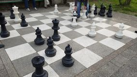 Old men playing giant chess. Old people outdoors in a park playing chess Stock Photos