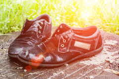 Old men`s shoes. Abandoned on the street after a rain. Worn and Royalty Free Stock Photography