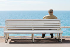 Old men by the sea. Old men sitting on the bench by the sea Royalty Free Stock Photo