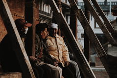 Old men sitting in Durbar square Royalty Free Stock Images