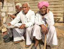 Old Men in the Street, Jaisalmer, India. Three Indian elders hanging out on the street in Jaisalmer, Rajasthan, India Royalty Free Stock Image
