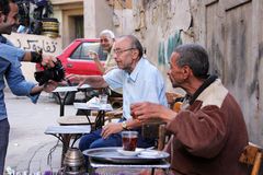 Egypt cairo. Old men taking photo in the street in poor district in cairo in egypt royalty free stock image