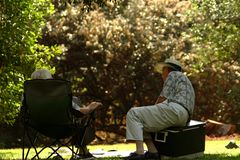 Old men talking. In park royalty free stock images