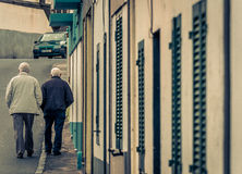 Old men walking Stock Images