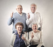 Old men and women. Two old men and two women with their thumbs up Stock Photos