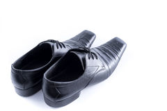 Old Mens shoes on white background,selective focus Royalty Free Stock Photo