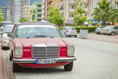 Old Mercedes on the street of the village of Kemer in Turkey in may. Old Mercedes on the street of the village of Kemer in Turkey. Old red car parked on the Stock Photography