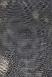 Old mesh quota of medieval armor. Detail of protection and security Stock Photo