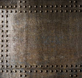 Old metal armour background with rivets Royalty Free Stock Image