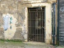 Old metal barred doorway padlocked and shut Stock Photos