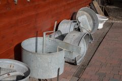 Old metal bathtub based on a wooden wall. Accessories for person. Al hygiene. Season of the autumn stock photos