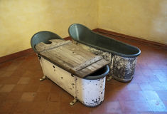 Old metal bathtubs Stock Images