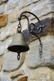 Old Metal Bell on Stone Wall, Czech Republic, Europe Stock Photography