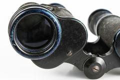 Old metal binoculars on a white table. Old military accessories