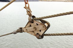 Old metal block and rigging Stock Image