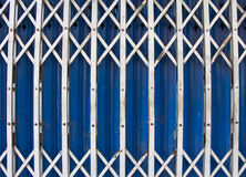 Old metal blue door in suburb Thailand Royalty Free Stock Photography