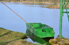 Old metal boat on the shore of the pond Stock Images