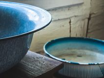 Old metal bowls at home stock image