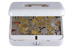 An old metal box full of coins Royalty Free Stock Photography
