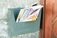 Old metal box for publicity. Near a door Stock Photo