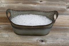 Old metal bucket filled with crushed ice on rustic wooden boards Royalty Free Stock Photography