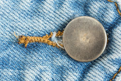 Old metal button of jeans Royalty Free Stock Photo